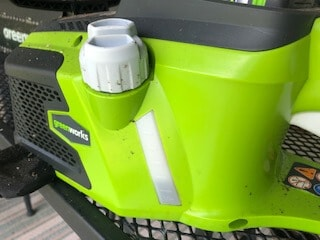 Changing oil in a greenworks chainsaw.