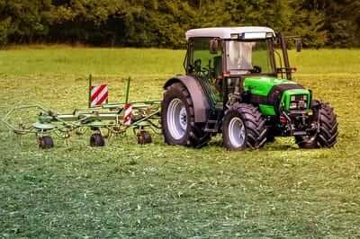 Noise-canceling headphones reduce engine sound during tractor work.