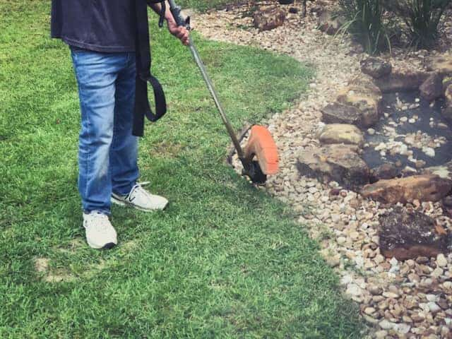 Edge with a string trimmer weed whacker