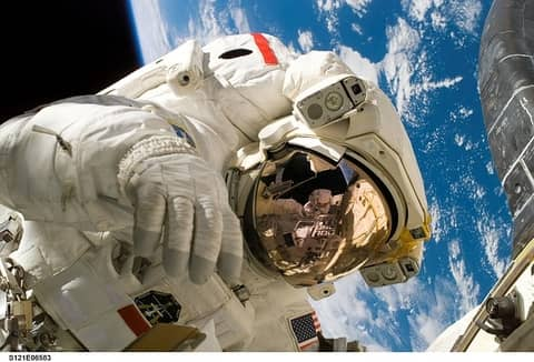 A human body will continue to decompose in the vacuum of space, though the decomposition process can be significantly slowed.