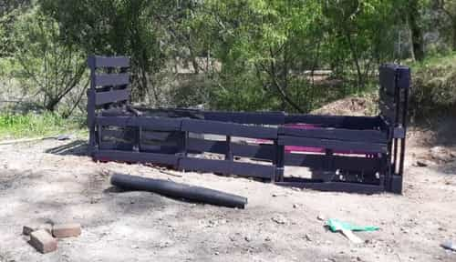 All sides of pallet garden bed secured and ready for weed guard and soil.