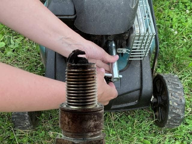 Identify a bad lawnmower spark plug