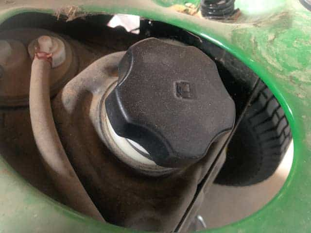 Lawnmower Spits Gas Out of Fuel Cap: Reasons and Fixes